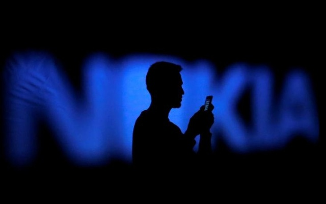 A photo illustration of a man silhouetted against a Nokia logo in the central Bosnian town of Zenica January 23, 2014. Reuters File Photo
