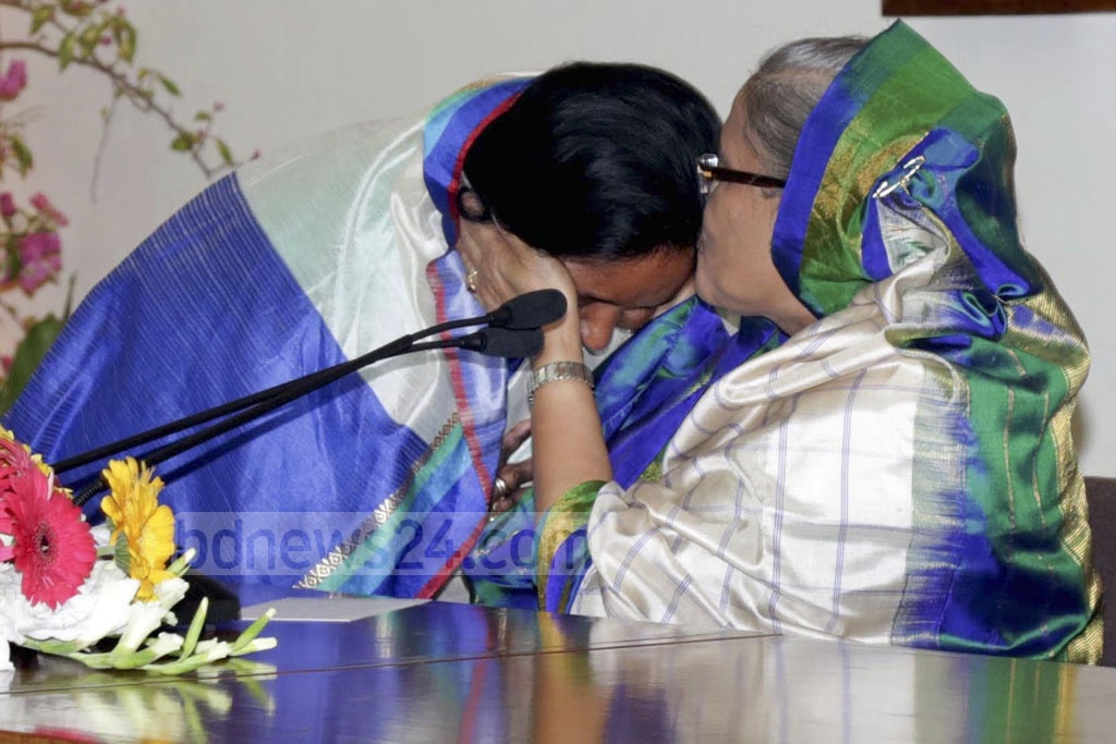 Prime Minister Sheikh Hasina kisses Awami League's Selina Hayat Ivy on her forehead. Ivy came to visit her party's chief at Ganabhaban on Friday, the day following her victory in Narayanganj mayor election.