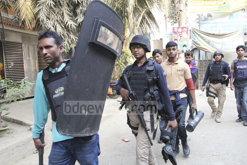 SWAT team members leaving a militant hideout at Dhaka's Ashkona on Saturday after completing a raid. Photo: asif mahmud ove