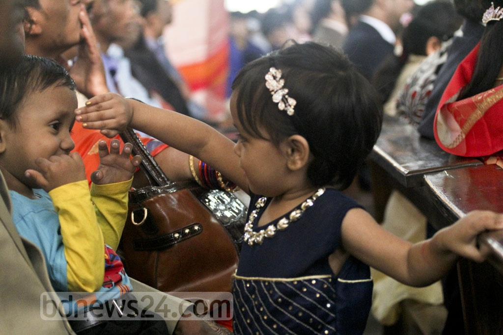 Two children play during a Christmas celebration at Farmgate's Holy Rosary Church on Sunday. Photo: asif mahmud ove