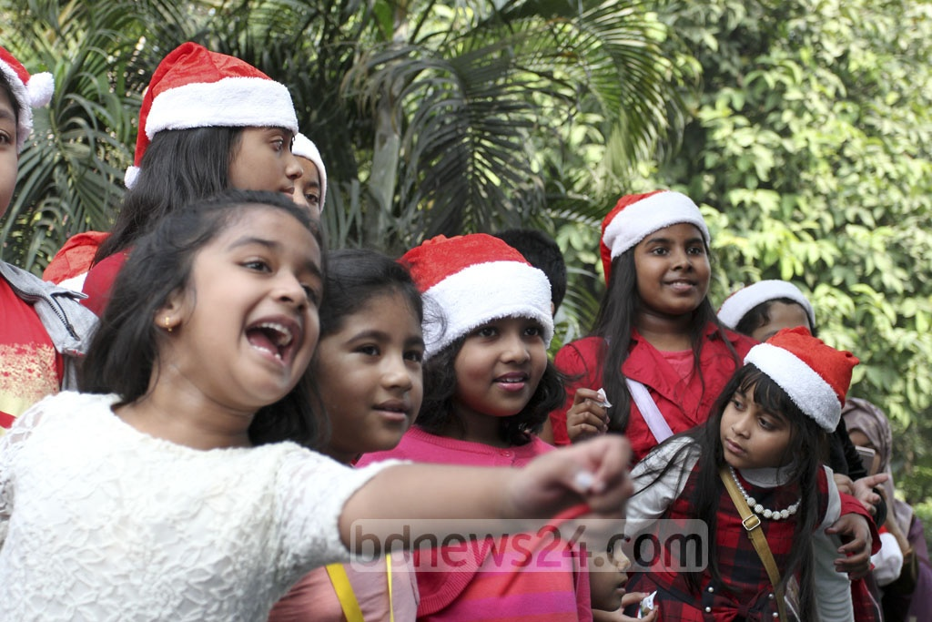 Children join Christmas festivities at a hotel in Dhaka. Photo: asif mahmud ove