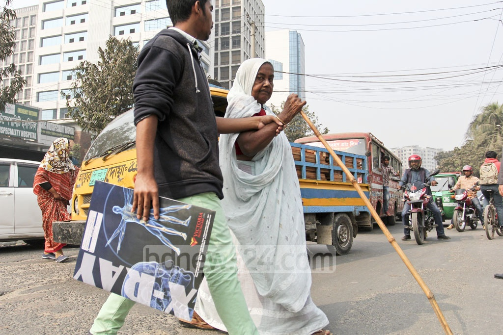 Hospital patients and their family members risk crossing the road near Shishu Mela in Dhaka's Shyamoli as the over-bridge is too far away. Photo: asif mahmud ove