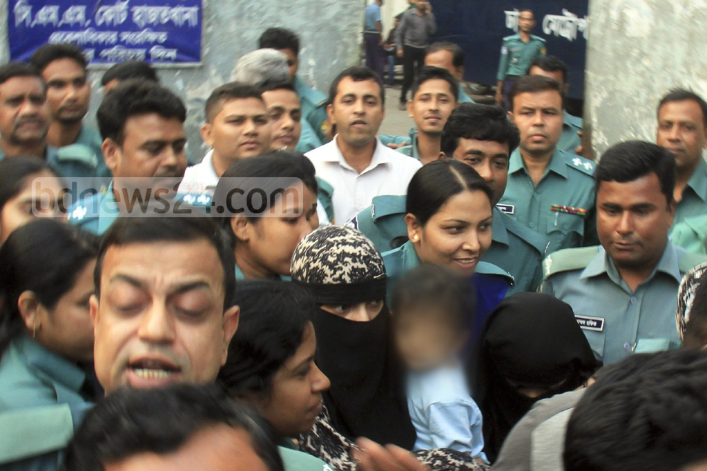 Police produced before a Dhaka court on Monday the two women who surrendered with their two daughters during a raid on a militant den in East Ashkona on Saturday.