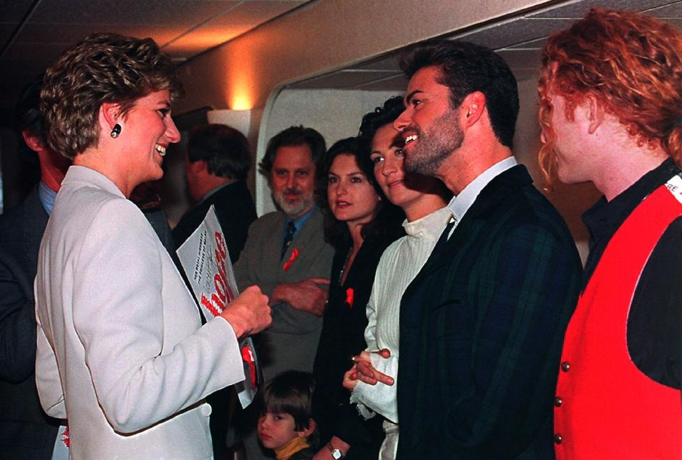 Princess Diana chats with singer George Michael before the start of the Concert of Hope at Wembley Arena in London to mark World AIDS Day December 1, 1993. To the immediate left of George Michael is singer KD Lang of Canada, and to the right Mick Hucknall of Simply Red. Reuters