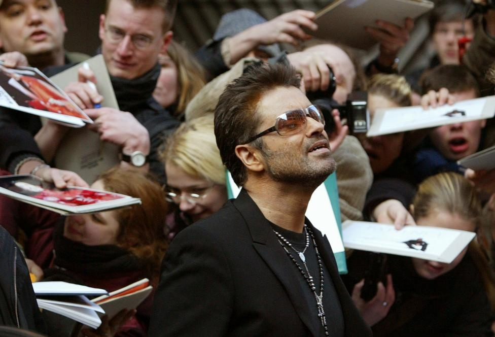 George Michael leaves a news conference for the film 'George Michael - A Different Story' in Berlin February 16, 2005. Reuters