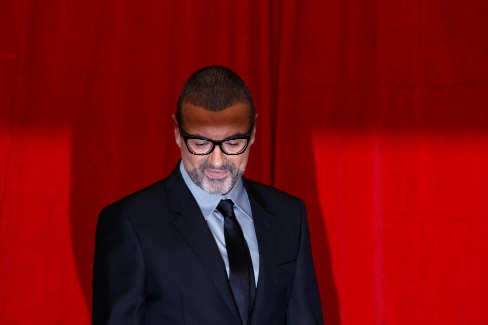 George Michael poses for photographers before a news conference at the Royal Opera House in central London May 11, 2011. Reuters