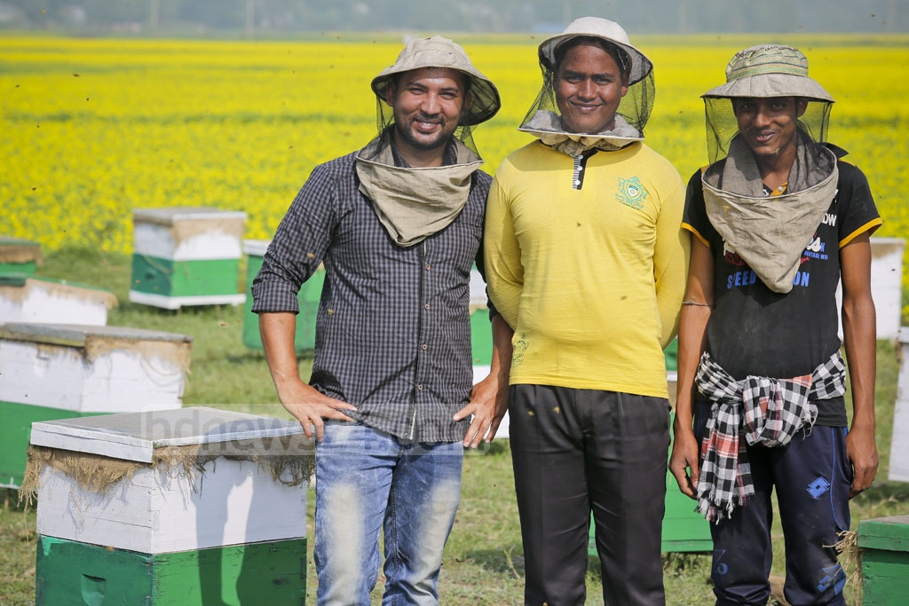 'Moti Modhu' beekeepers pose for a photo at their Munshiganj bee yard on Tuesday. Photo: asaduzzaman pramanik