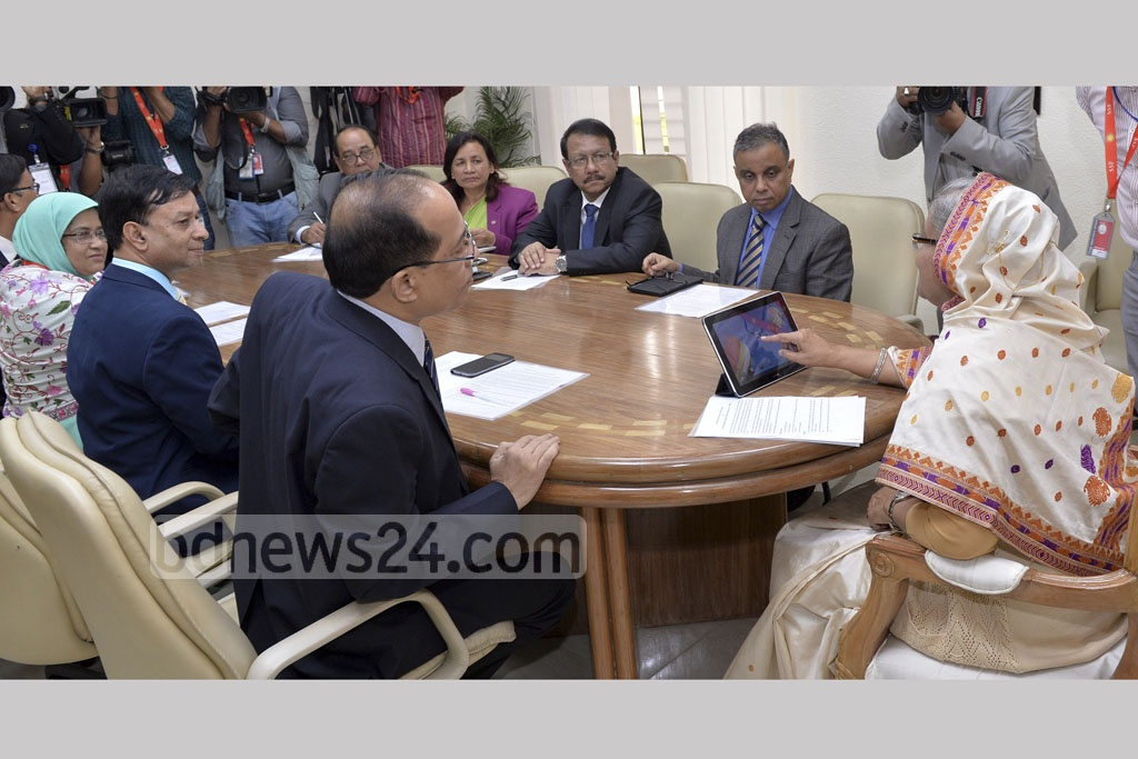 Prime Minister Sheikh Hasina clicks on her tablet to inaugurate a weather app by the Bangladesh Meteorological Department at the Prime Minister's Office on Tuesday.