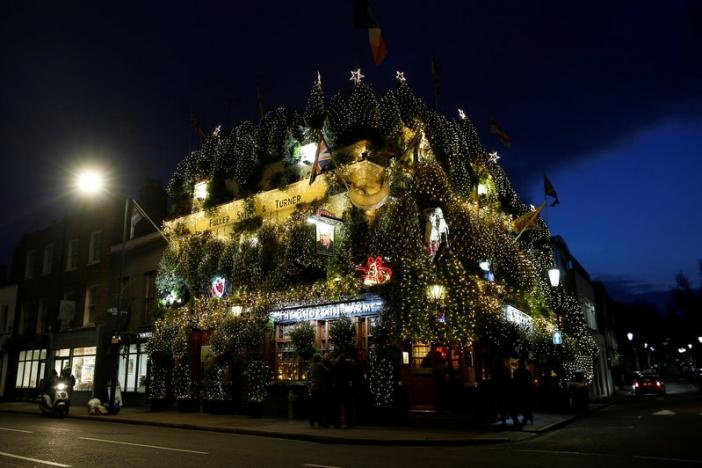 The Churchill Arms pub is illuminated and covered in Christmas decorations in London, Britain December 20, 2016. REUTERS