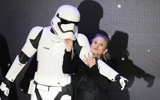 Carrie Fisher poses for cameras as she arrives at the European Premiere of Star Wars, The Force Awakens in Leicester Square, London, December 16, 2015. Reuters