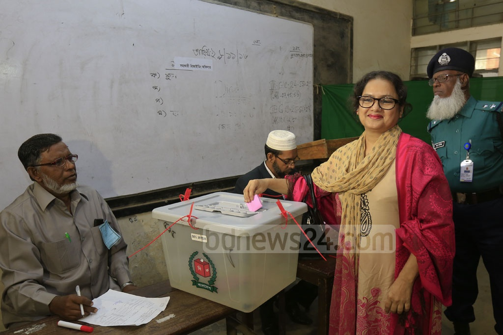 A voter casts her vote at a polling station set up in a school at Dhaka's Banani during the District Council Polls on Wednesday.