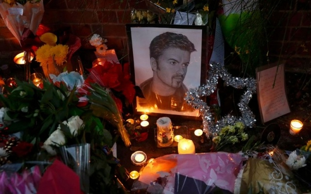 Tributes are seen outside the house of singer George Michael, where he died on Christmas Day, in Goring, southern England, December 26, 2016. Reuters