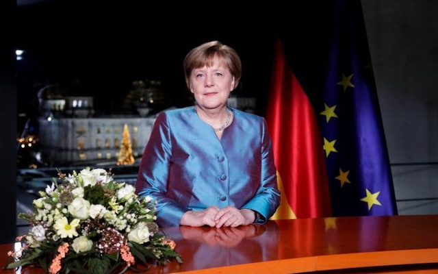 German Chancellor Angela Merkel poses for photographs after the television recording of her annual New Year's speech at the Chancellery in Berlin, Germany, December 30, 2016. Reuters