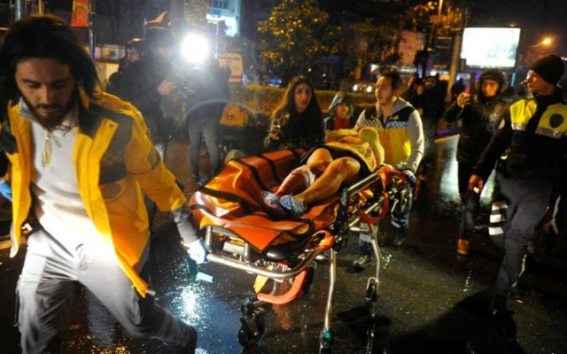 An injured woman is carried to an ambulance from a nightclub where a gun attack took place during a New Year party in Istanbul, Turkey, Jan 1, 2017. Reuters
