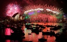 Fireworks explode over the Sydney Opera House and Harbour Bridge as Australia ushers in the New Year in Sydney, January 1, 2017. REUTERS