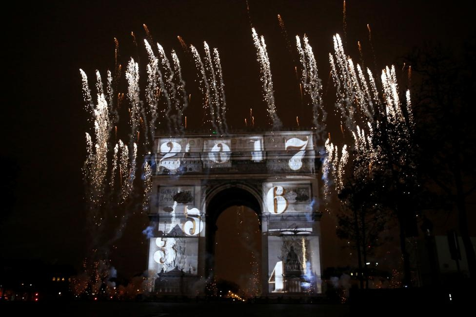View of a light show on the city's iconic Arc de Triomphe monument during the New Year celebration in Paris, France, January 1, 2017. REUTERS