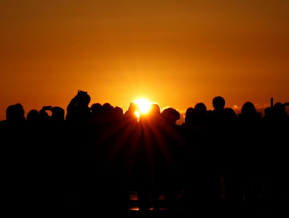 People watch the first sunrise on New Year's Day at Roppongi Hills observation deck in Tokyo, Japan, January 1, 2017. REUTERS