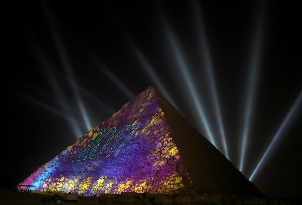 Lights reading 2017 are projected on the pyramids during New Year's day celebrations on the outskirts of Cairo, Egypt, January 1, 2017. REUTERS