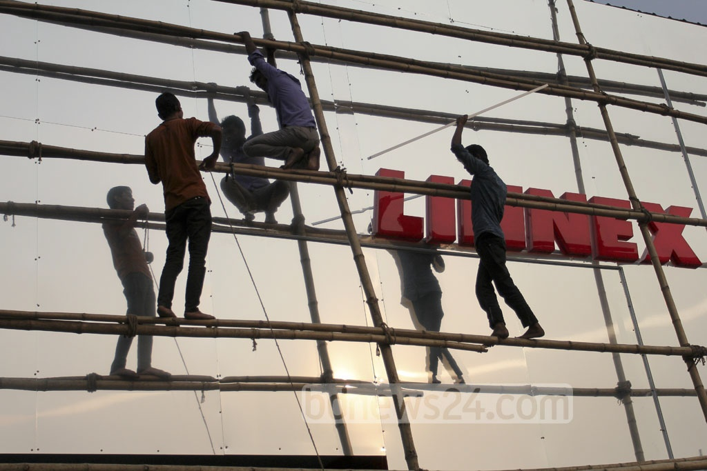Construction of pavilions and shops continue on Monday even as the month-long Dhaka International Trade Fair kickstarted at the Sher-e-Bangla Nagar on Sunday. Photo: asif mahmud ove