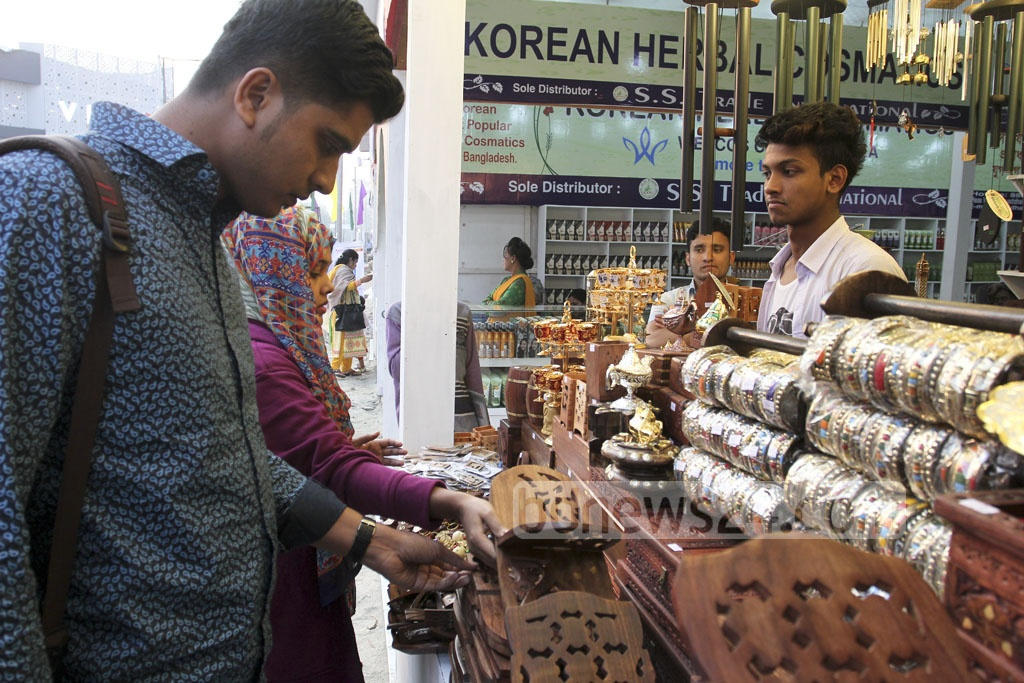Visitors take a look at the stalls on the second day of the Dhaka International Trade Fair at Sher-e-Bangla Nagar on Monday. Photo: asif mahmud ove
