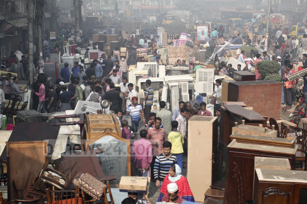 Goods of the DNCC Market and adjacent shops piled on Tejgaon Link Road following the massive fire at the DNCC Market at Gulshan-1 on Tuesday. Photo: asif mahmud ove