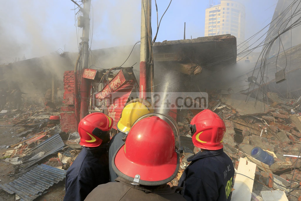 Firefighters continue to spray water on the charred ruins of Gulshan DNCC Market on Wednesday, after it took more than a day to douse the massive fire.