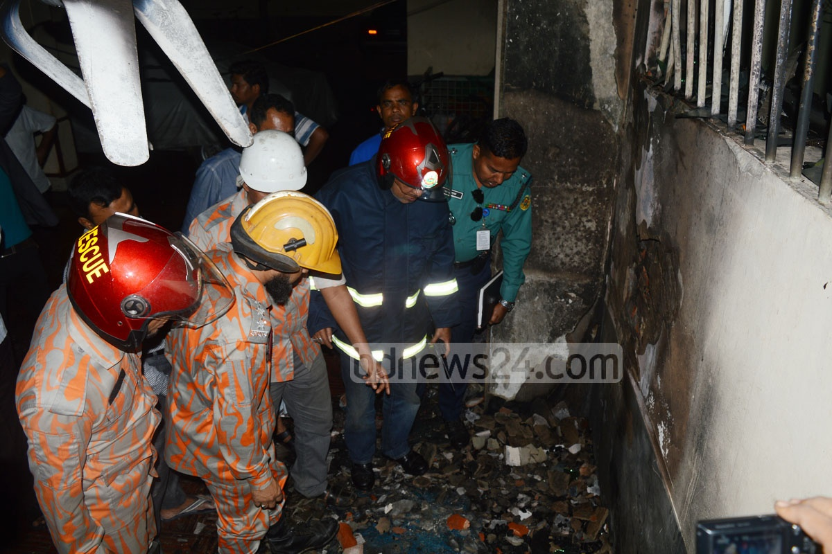 Firefighters inspect the lower storey of Green Tower at Chittagong after a fire started by a generator explosion on Tuesday.
