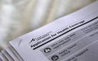The federal government forms for applying for health coverage are seen at a rally held by supporters of the Affordable Care Act, widely referred to as ''Obamacare'', outside the Jackson-Hinds Comprehensive Health Center in Jackson, Mississippi, US on October 4, 2013. Reuters