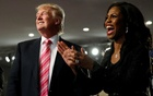 Republican presidential nominee Donald Trump and Omarosa Manigault (R) attend a church service, in Detroit, Michigan, US, September 3 2016. Reuters