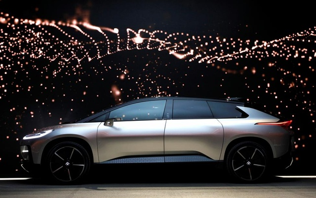 A Faraday Future FF 91 electric car is displayed on stage during an unveiling event. Reuters