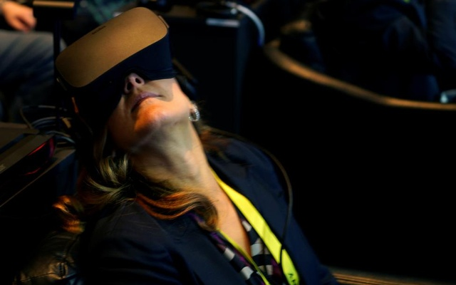 A showgoer wears an Oculus Rift virtual reality headset during the Intel press conference. Reuters