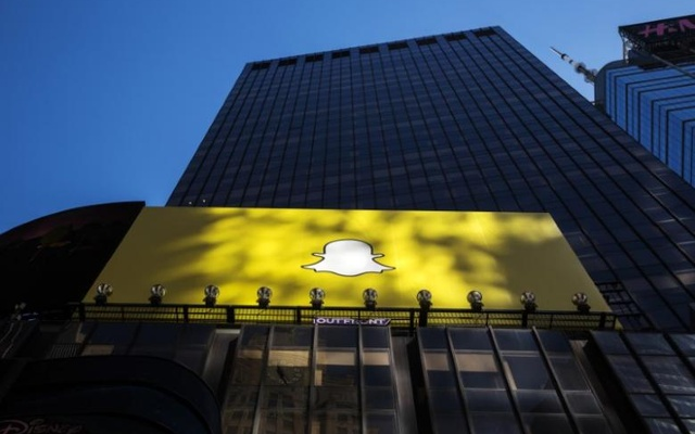 A billboard displays the logo of Snapchat above Times Square in New York March 12, 2015. Reuters