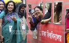 Shamsunnahar Hall alumnae pose for photo from a set, which looks like a bus in which they commute when they were students of Dhaka University, at a reunion on Friday. Photo: abdul mannan