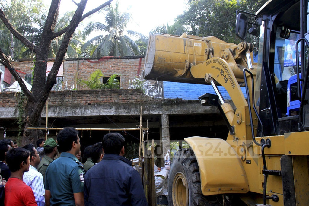 Dhaka South City Corporation evicts illegal structures at Dhaka's Shahbagh area on Sunday.