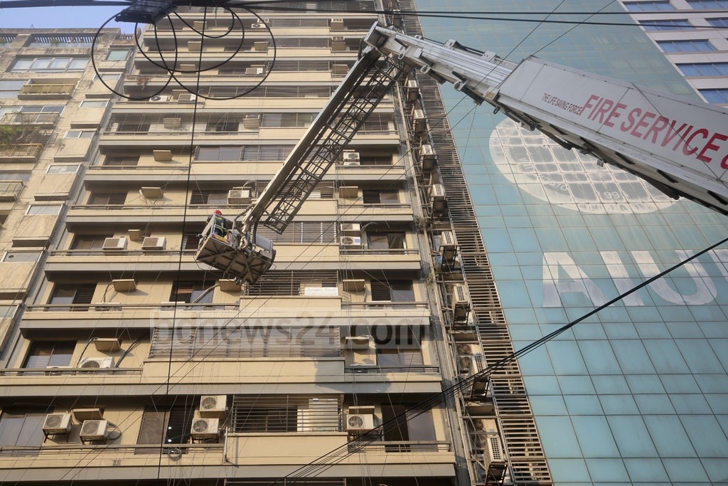 Fire Service workers try to douse the flames at a high-rise in Dhaka's Banani on Monday.
