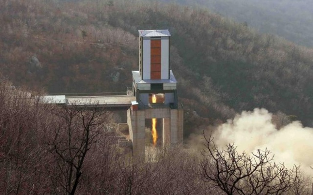 A new engine for an intercontinental ballistic missile (ICBM) is tested at a test site at Sohae Space Center in Cholsan County, North Pyongan province in North Korea in this undated photo released by North Korea's Korean Central News Agency (KCNA) on April 9. Reuters