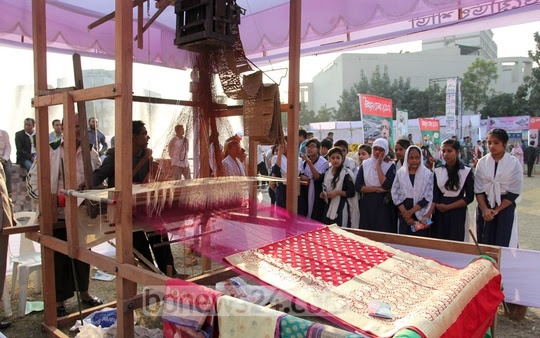 A hand loom machine is on display at the 'Development Fair' organised by the district administration at the Shilpakala Academy ground in Dhaka on Monday.