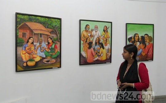 A visitor at the art exhibition organised by the students of the 50th batch of the Faculty of Fine Arts at the Zainul Gallery at Dhaka University on Monday.