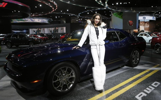 Model Amanda Rodriguez poses with the all-wheel drive 2017 Dodge Challenger. Reuters