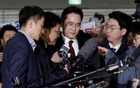Jay Y Lee, centre, vice chairman of Samsung Electronics, arrives to be questioned as a suspect in bribery case in the influence-peddling scandal that led to the president's impeachment at the office of the independent counsel in Seoul, South Korea, Thursday, Jan 12, 2017. Reuters