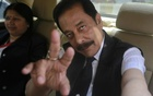 File Photo: Sahara Group Chairman Subrata Roy gestures as he arrives at the Securities and Exchange Board of India (SEBI) headquarters in Mumbai April 10, 2013. Reuters