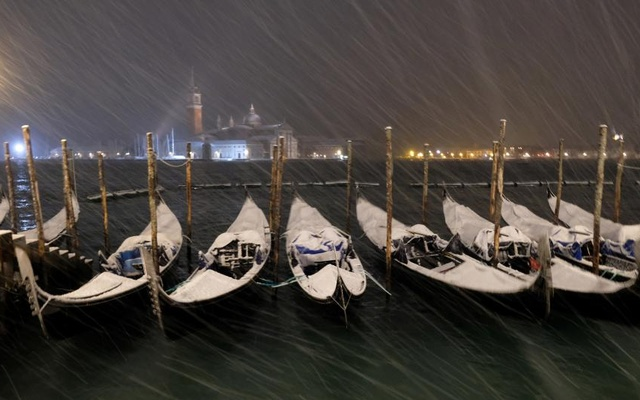 Gondolas are seen during snowfall in the Venice lagoon, northern Italy. REUTERS