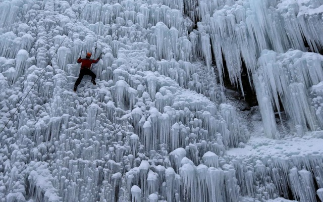 A man climbs an artificial wall of ice in the city of Liberec, Czech Republic. REUTERS