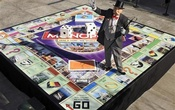 'Mr. Monopoly' stands on a large version of the global game board of the new 'Monopoly Here & Now: The World Edition' after it was unveiled on the CBS Early Show in New York, August 20, 2008. Reuters