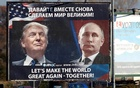 Pedestrians cross the street behind a billboard showing pictures of US president-elect Donald Trump and Russian President Vladimir Putin in Danilovgrad, Montenegro, November 16. 2016. Reuters