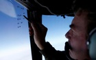 Squadron leader Brett McKenzie marks the name of another search aircraft on the windshield of a Royal New Zealand Air Force P-3K2 Orion aircraft searching for missing Malaysian Airlines flight MH370 over the southern Indian Ocean March 22, 2014. Reuters