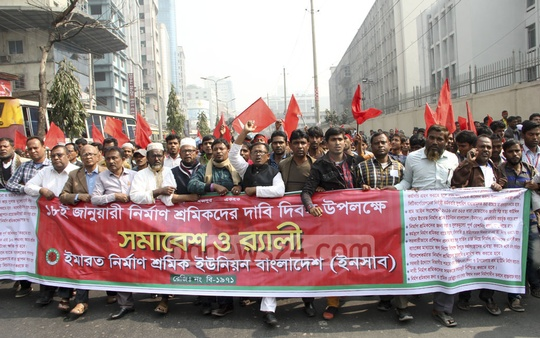 Construction workers march in front of the National Press Club in Dhaka on Wednesday after a rally in support of 'Demand Day' on Jan 18.
