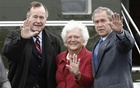 Then US President George W Bush (R) waves alongside his parents, former president George HW Bush and former first lady Barbara Bush upon their arrival in Fort Hood, Texas, in this April 8, 2007 file photo. Reuters