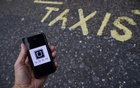 A photo illustration shows the Uber app logo displayed on a mobile telephone, as it is held up for a posed photograph in central London, Britain October 28, 2016. Reuters