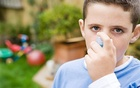 A boy uses an asthma inhaler in a handout photo. Reuters